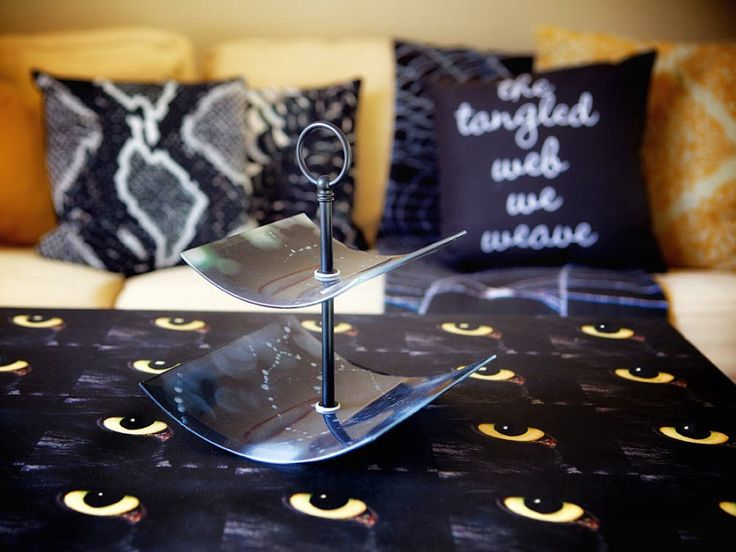 This two tiered tray is made out of  Shutterfly curved glass prints , the pillows in the background are all Shutterfly and the table with the cat eyes is made out of Shutterfly's wooden wall art that I photoshopped a pattern onto.