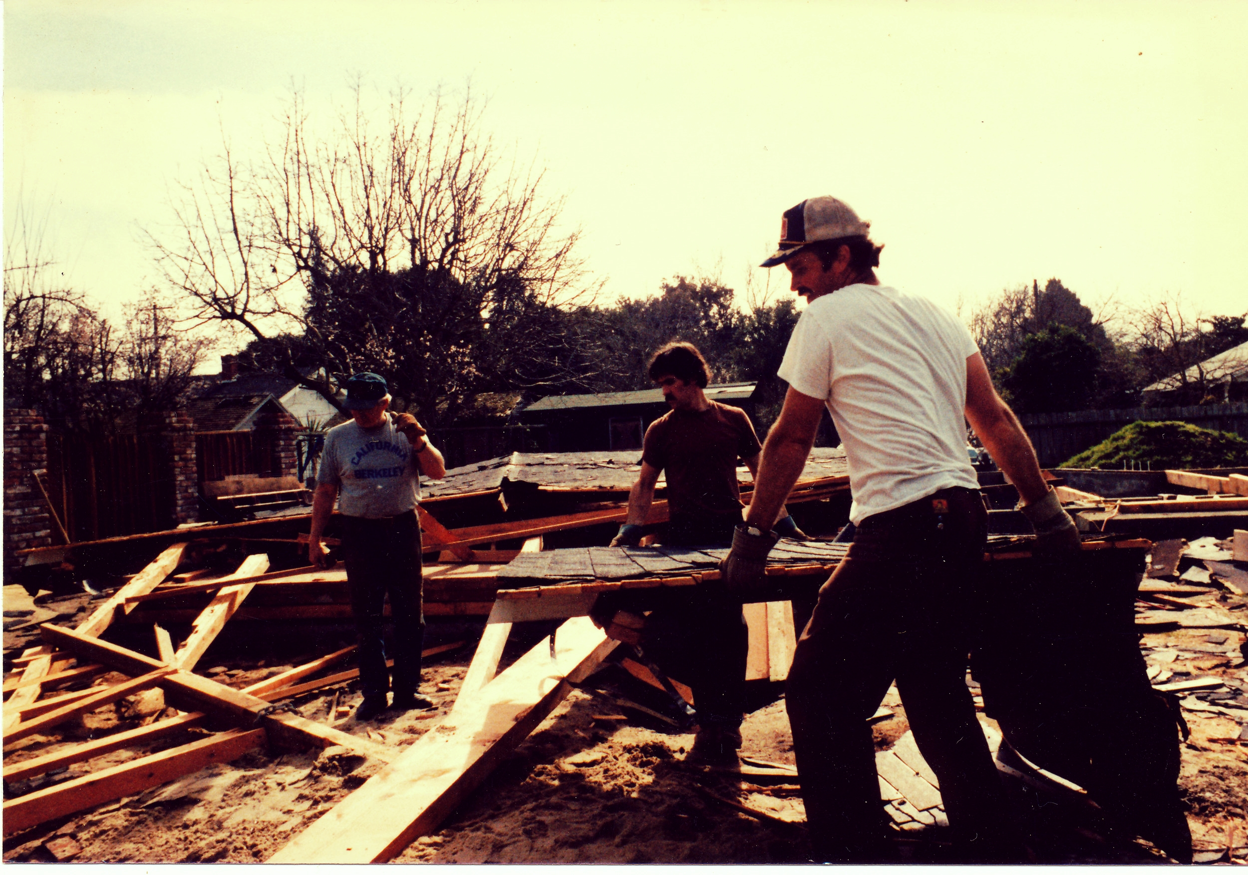 Pictured right to left: brothers John and Robert, and their father Paul working on a house in Palo Alto in the 1970s.