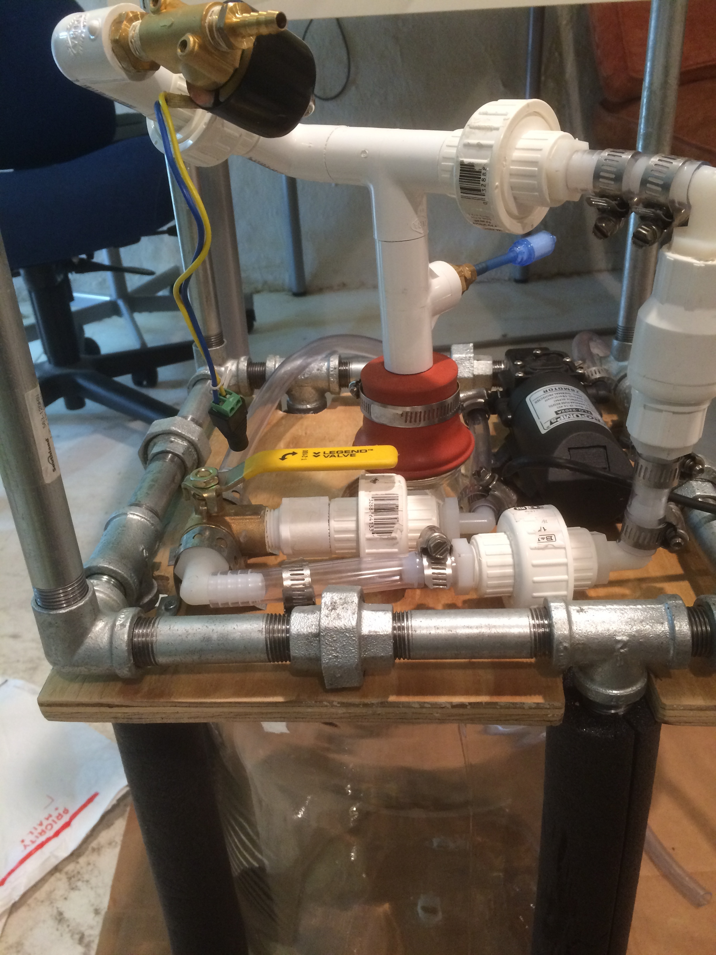 A diaphragm pump was chosen to circulate the liquids because they are self-priming and less-detrimental to bacterial populations than centrifugal pumps. 3-way valves controlled flow & filling (manually) and a solenoid valve controlled the dispensing of the liquid culture.