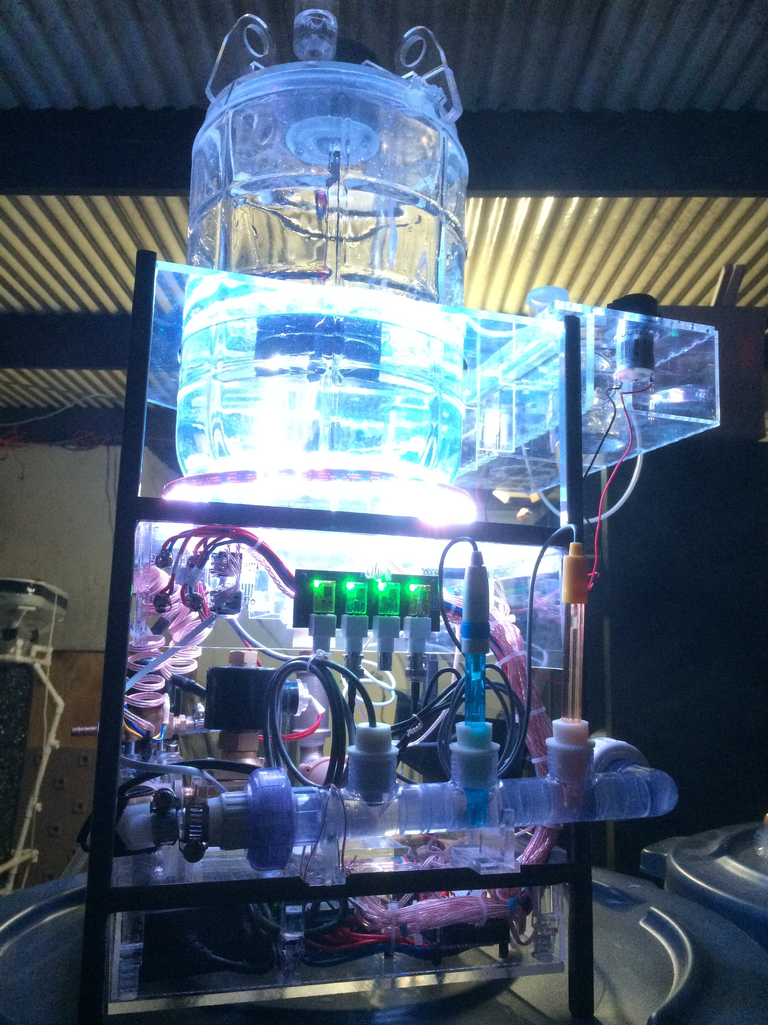 The end result of a few intense weeks of fabrication was a machine which could continuously 'brew' a liquid culture of aerobic or anaerobic bacteria and/or fungi (automated kombucha machine, anyone?) with solid/liquid inputs & liquid output dispensing being  mechanically regulated , agitation (spin mixing), color-based indicator lights, and aqueous chemistry monitoring (pH, EC, DO, temperature, etc.).