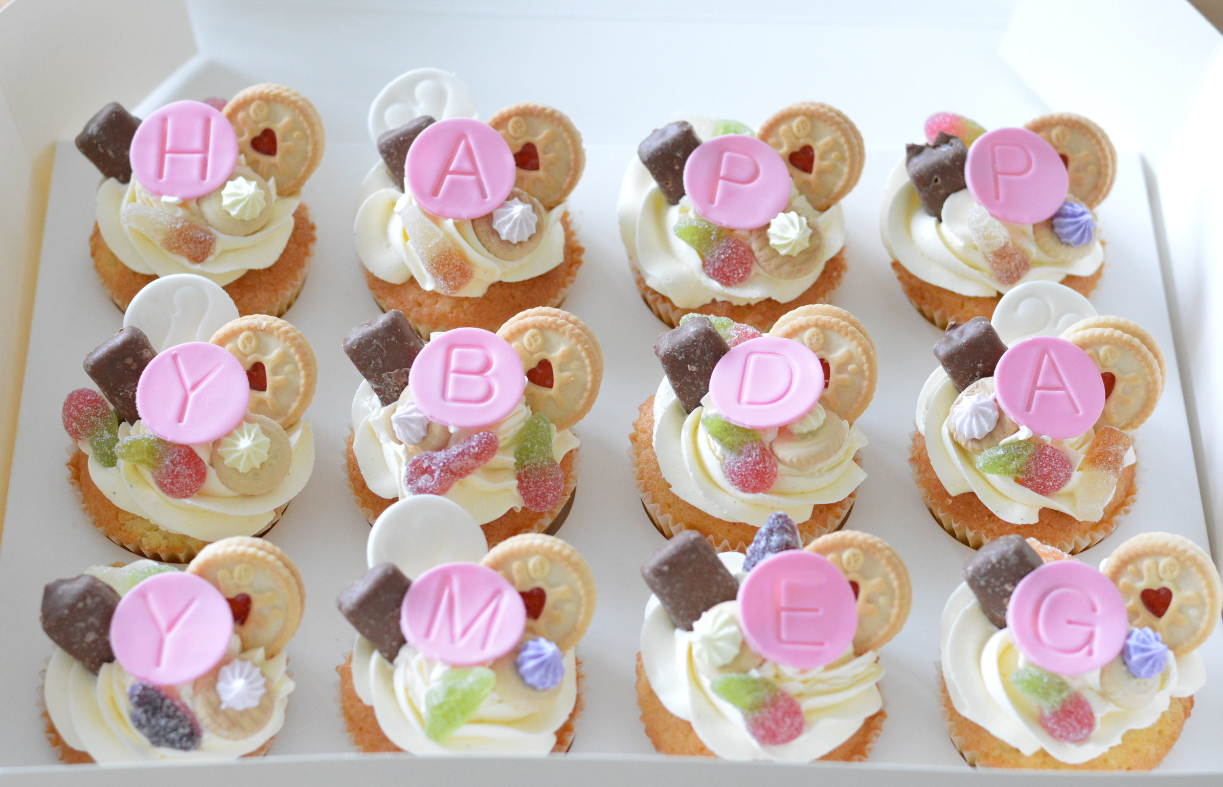 £32.00 for 12  HAPPY BIRTHDAY CUPCAKES - Topped with yummy sweet shop treats and mini biscuits.