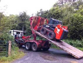 Transporting forestry mulcher to site in Birmingham
