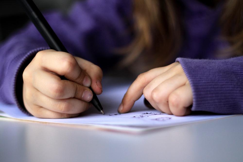 kid writing [ source ]