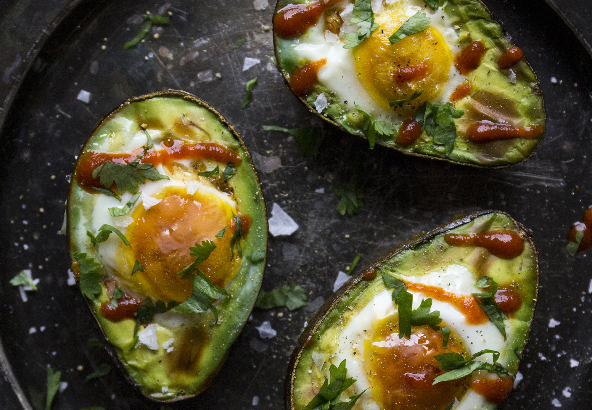 Spicy Avocado Baked Eggs    Shake up your breakfast routine with these spicy avocado baked eggs!