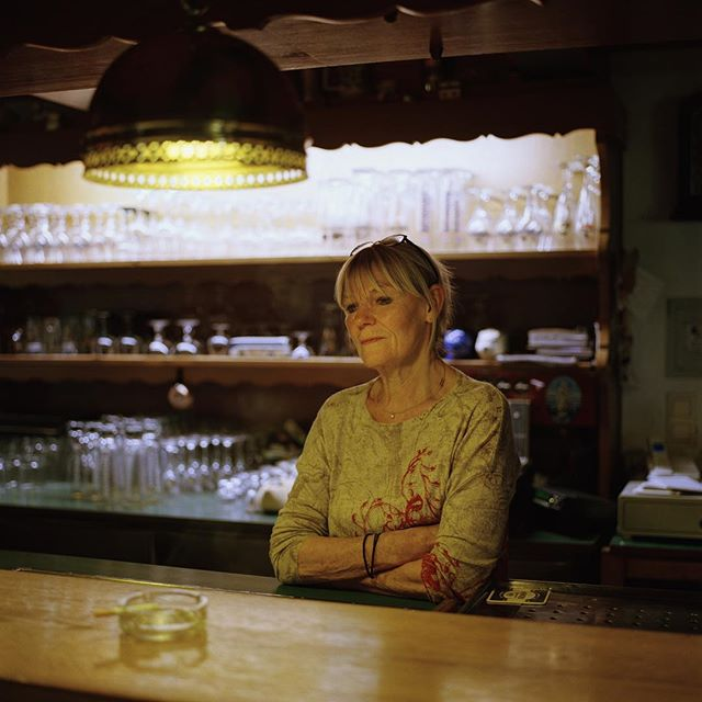 "Annemarie Petzi runs the oldest pub called ""Friesenpesel"" on Hooge. She has many great stories to tell. During summer many day tourists come by while during the other times in the year the place is more quiet and more frequented by locals. I highly recommend going there for a beer, some food and a good chat at the bar. —— If you would like to help me fund the next leg of a new longterm project I will start this May in Scotland (more about it soon): I will be giving 50% off on my 60x60cm C-Prints made on Fuji Crystal Paper which are available in a limited edition of 10. For 280€ (tax & shipping in Europe included) you can get your own print. Just drop me a line at mail@tonysojka.com with your enquiry. Other sizes are available as well.  I would be grateful if you could spread the word, share this or tag your friends in the comment. Thank you for your support!"