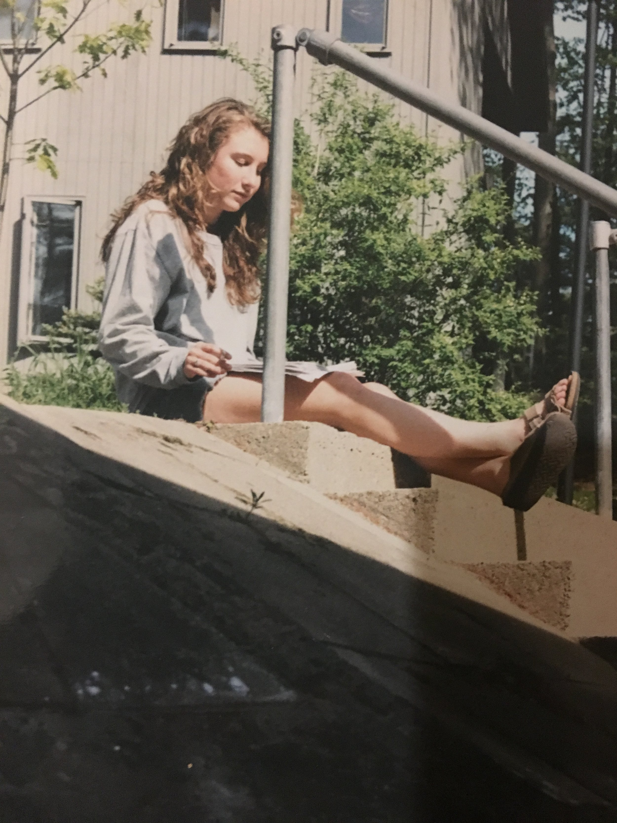 """Me """"studying and smoking outside my dorm room, back when photos were taken on film and printed at the local CVS...."""