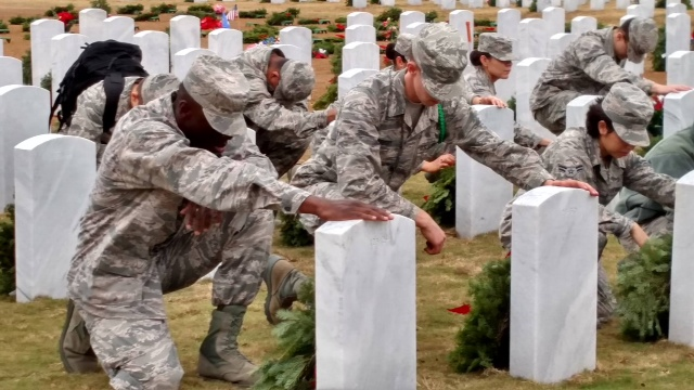 Medical students from US Army Medical Department Center and School Health Readiness Center of Excellence pay their respects at Fort Sam Houston National Cemetery. Photo Credit: Terry Reynolds