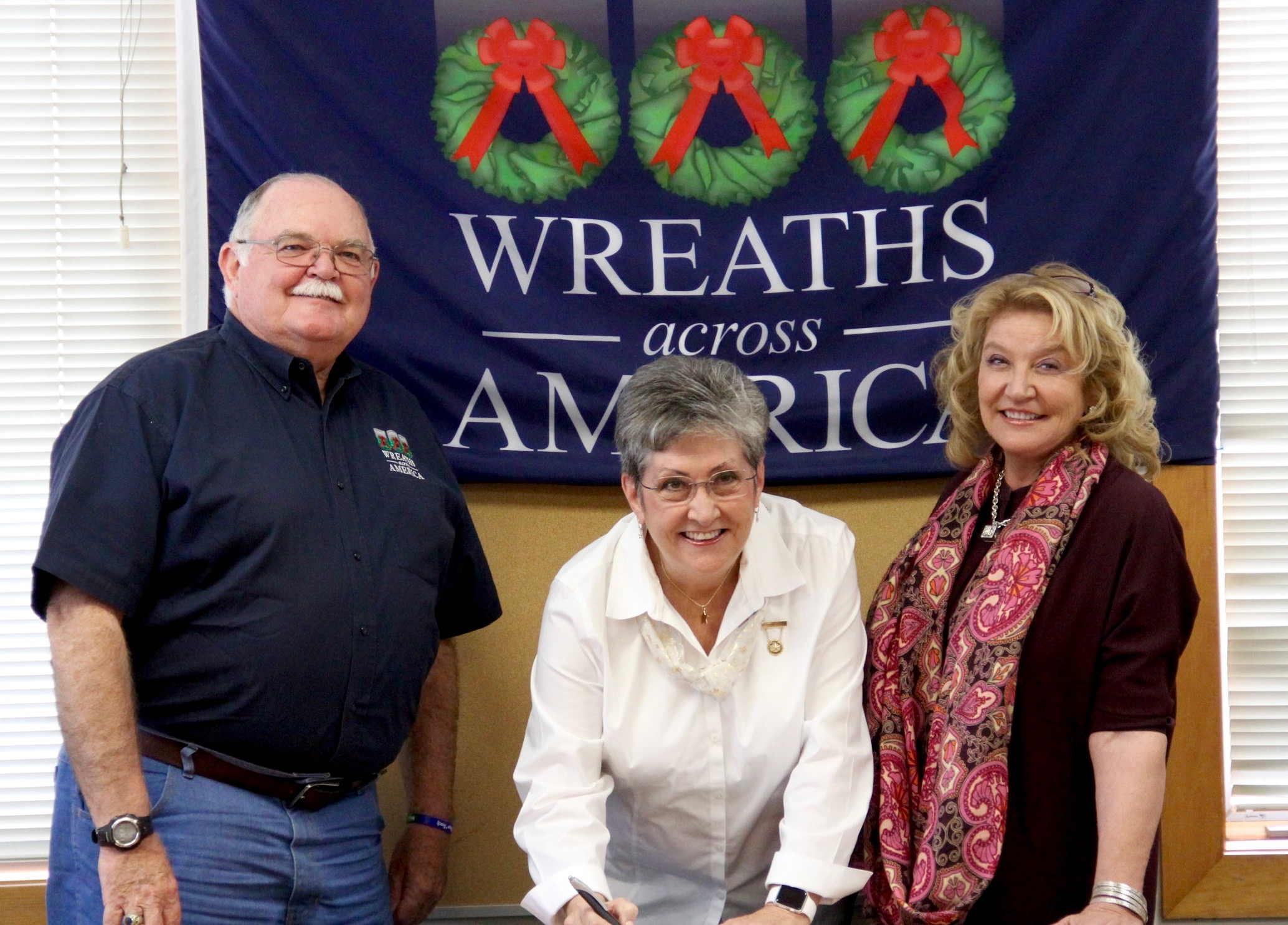 Wayne Hanson, Wreaths Across America's Chairman of the Board with AGSM President Candy Martin and Wreaths Across America's Executive Director, Karen Worcester at agreement signing October 20, 2016