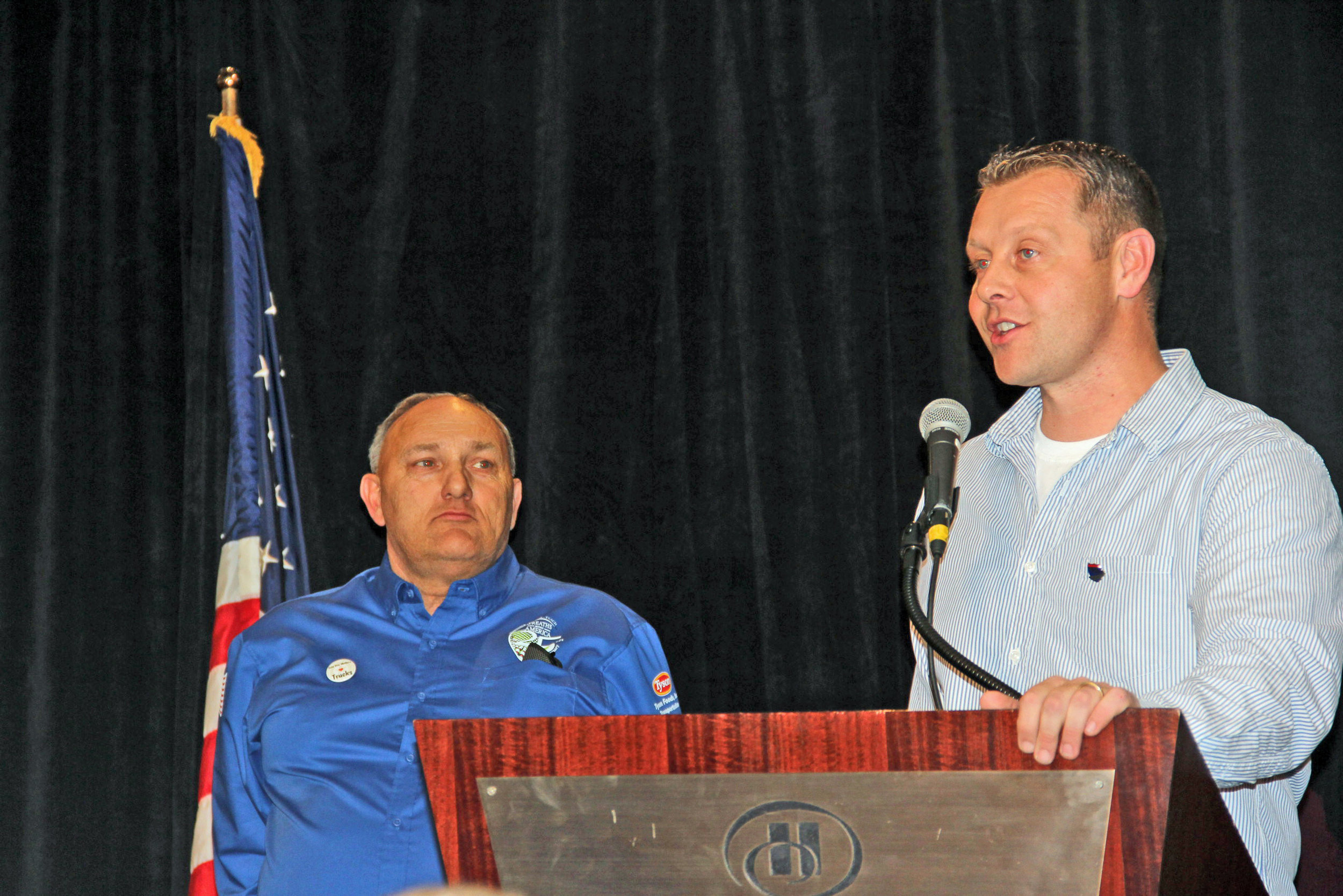 """Jimmy is seen here (left) on stage as Rob Worcester presents him with the """"Above and Beyond"""" award during the 2016 TCA driver appreciation dinner sponsored by Pilot Flying J."""