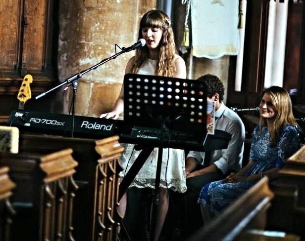 Playing and singing at a wedding in 2014