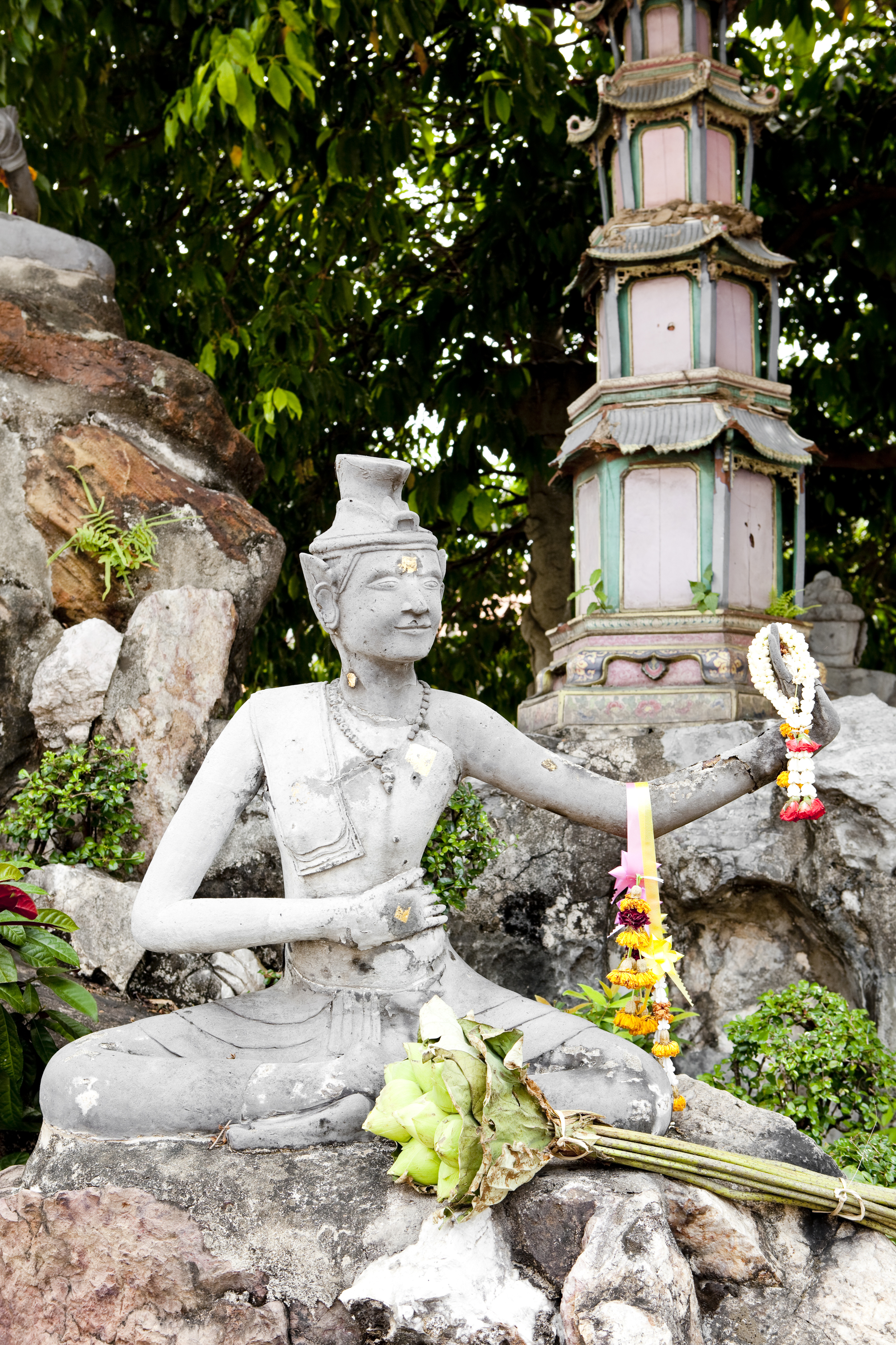 Thai statue of hermit yogi practicing Reusi Dat Ton, an ancient form of therapeutic yoga that aids in meditation practice