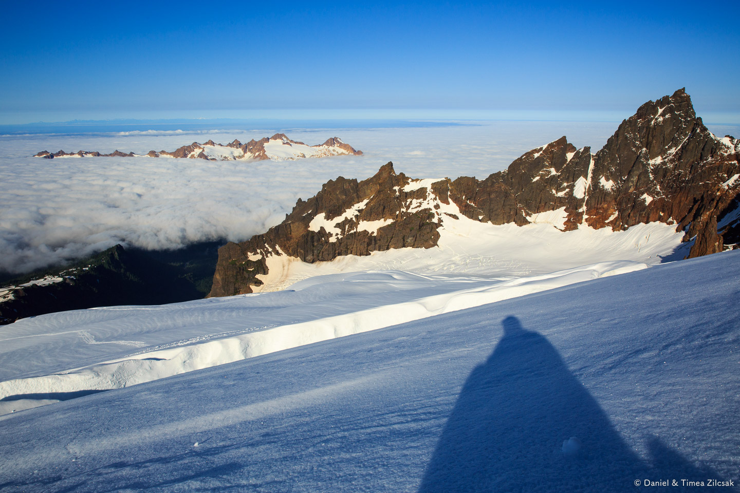 Climbing Mt Baker - Taking a break above a large crevasse