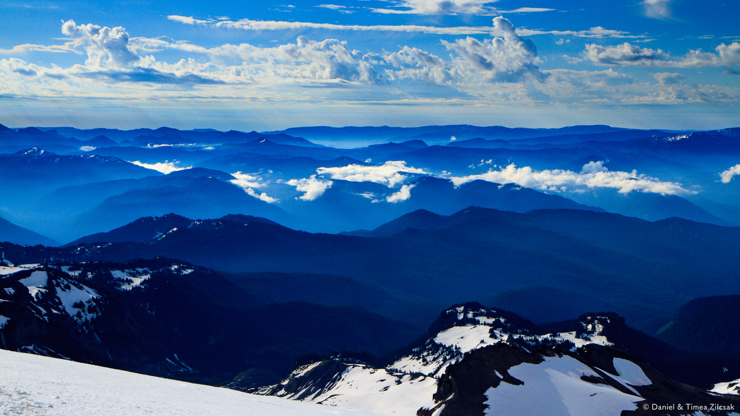 The Cascade Mountains look like hills from 9k on the Muir snowfield near Moon Rocks and Camp Muir