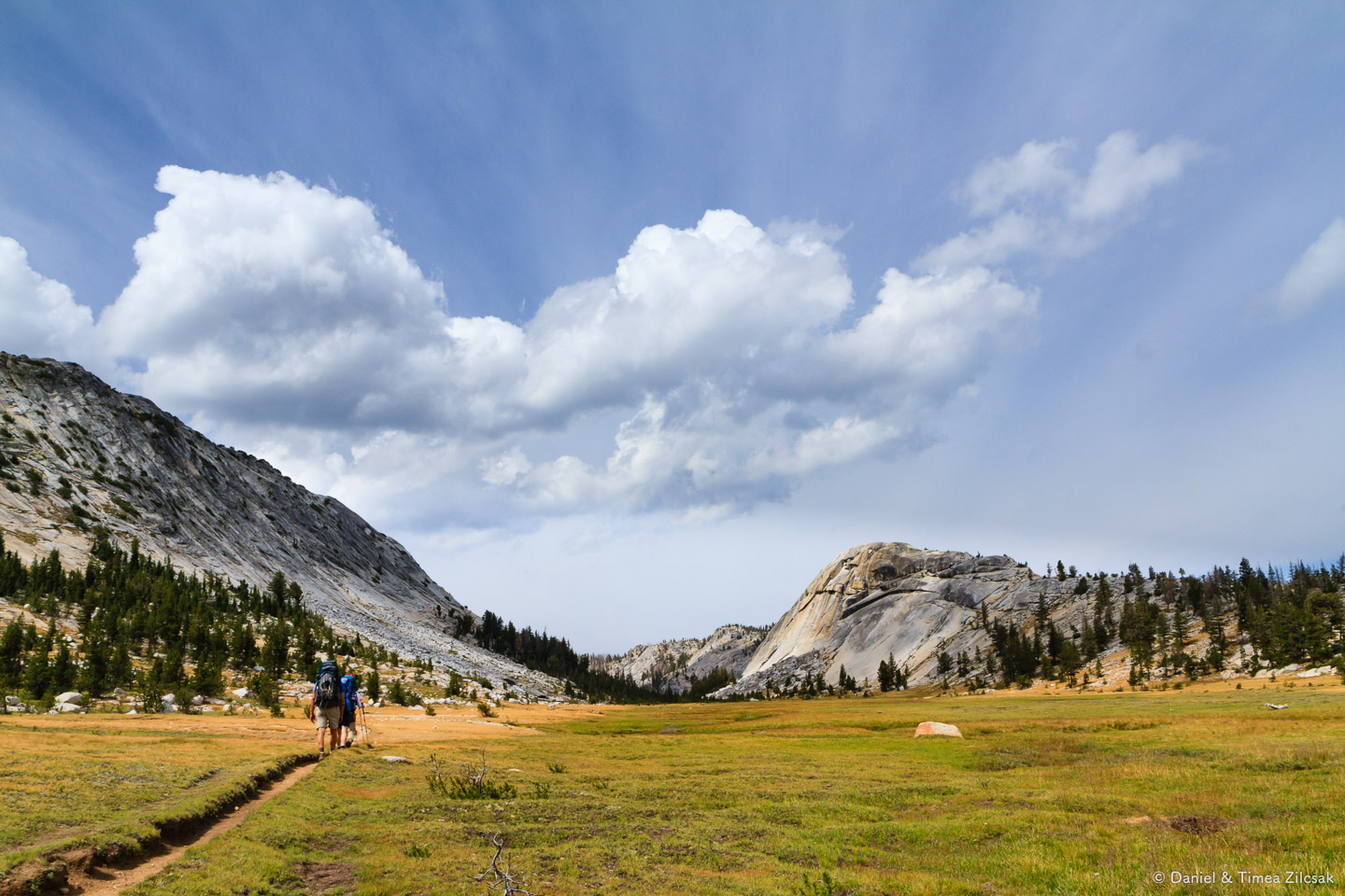 Backpacking across a beautiful meadow on our way to Merced Lake,