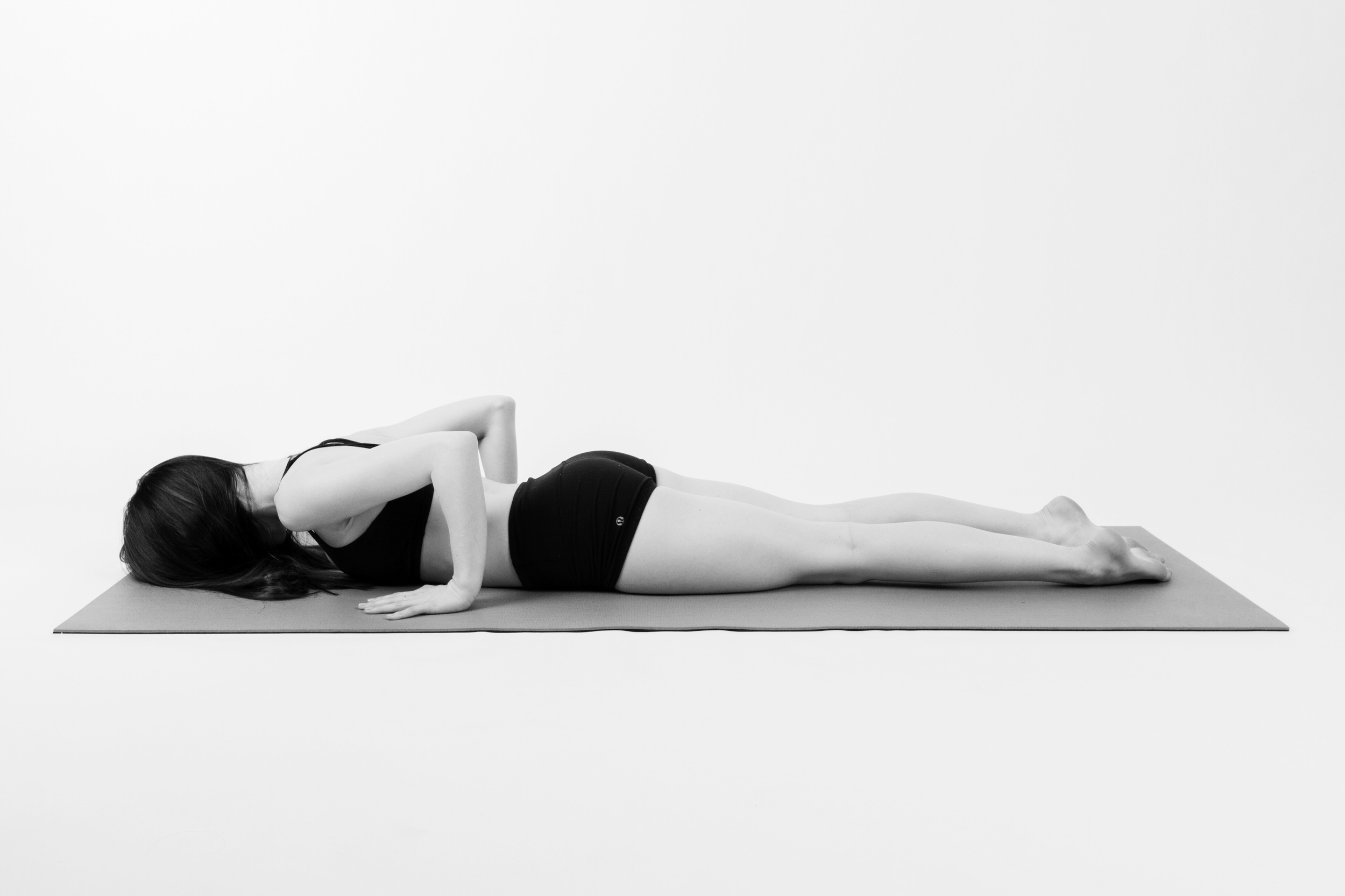 TRANSITION TO BELLY        Slowly exhale and lower back down to your belly, tuck your chin.