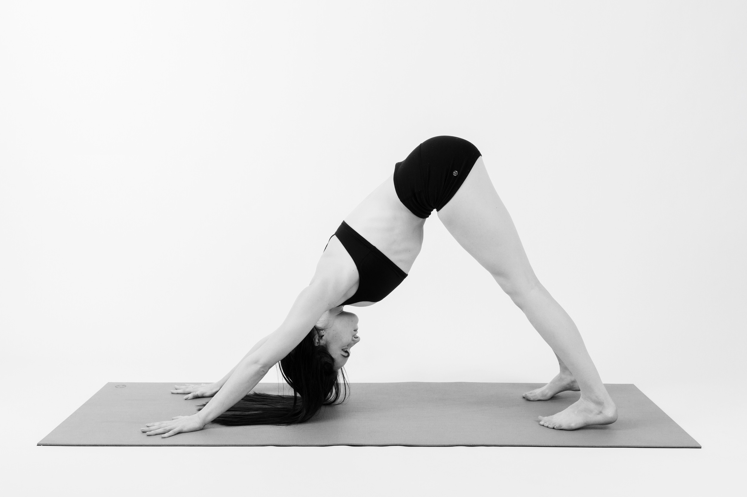DOWNWARD FACING DOG     Exhale lift your hips up and back. Turn your gaze towards your navel.     Repeat these movements linked together as a sequence for a few rounds. You decide how fast or slow to go. Traditionally Sun Salutations were used in yoga as a warm up, so don't be afraid to push yourself and really get your heart pumping.