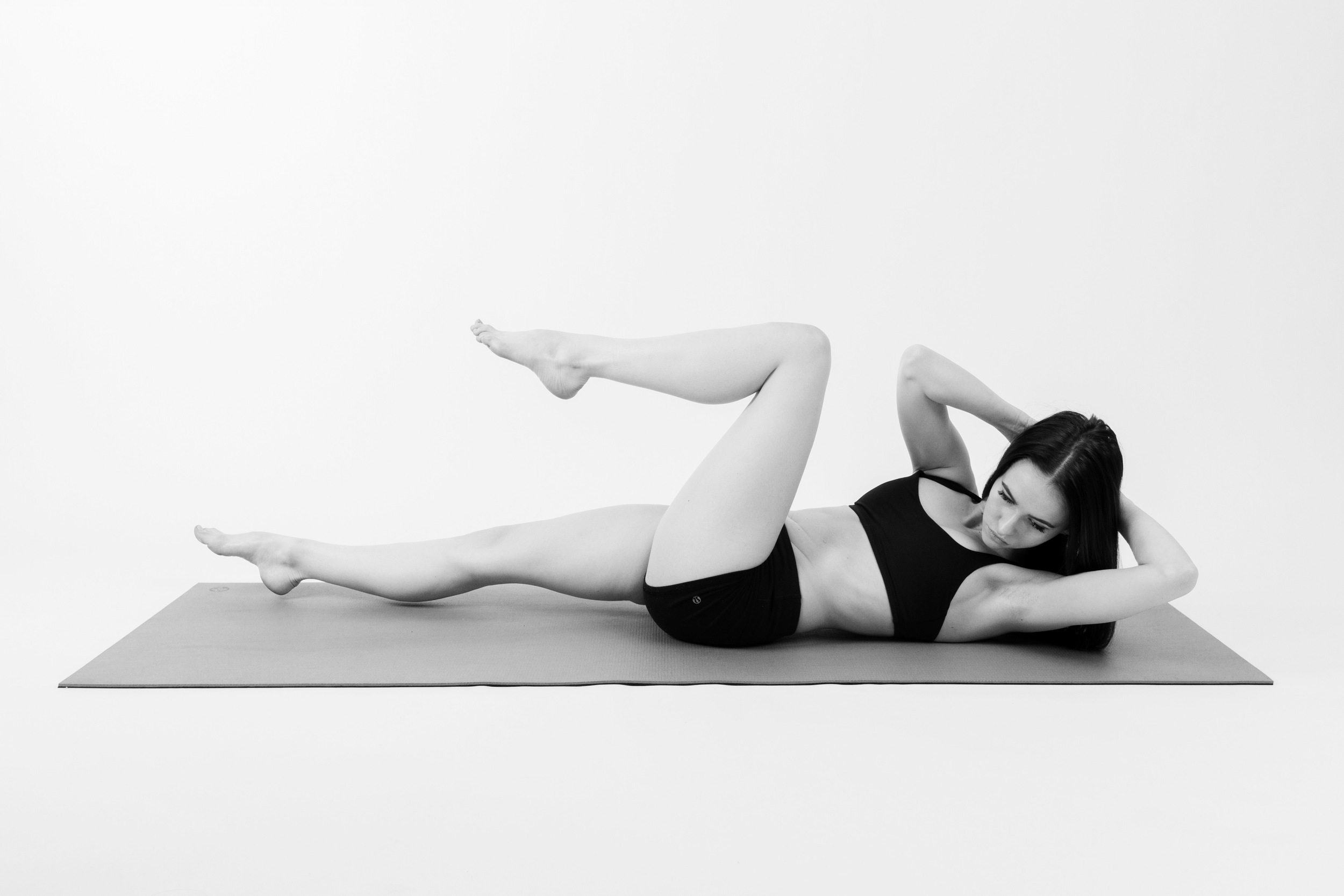 BICYCLE CRUNCHES     Inhale lean back out and switch your legs, right knee in and left leg out long.    Exhale twist to the right, bring your left elbow to your right knee.    Continue this motion, inhale changing legs and exhale crunching in.