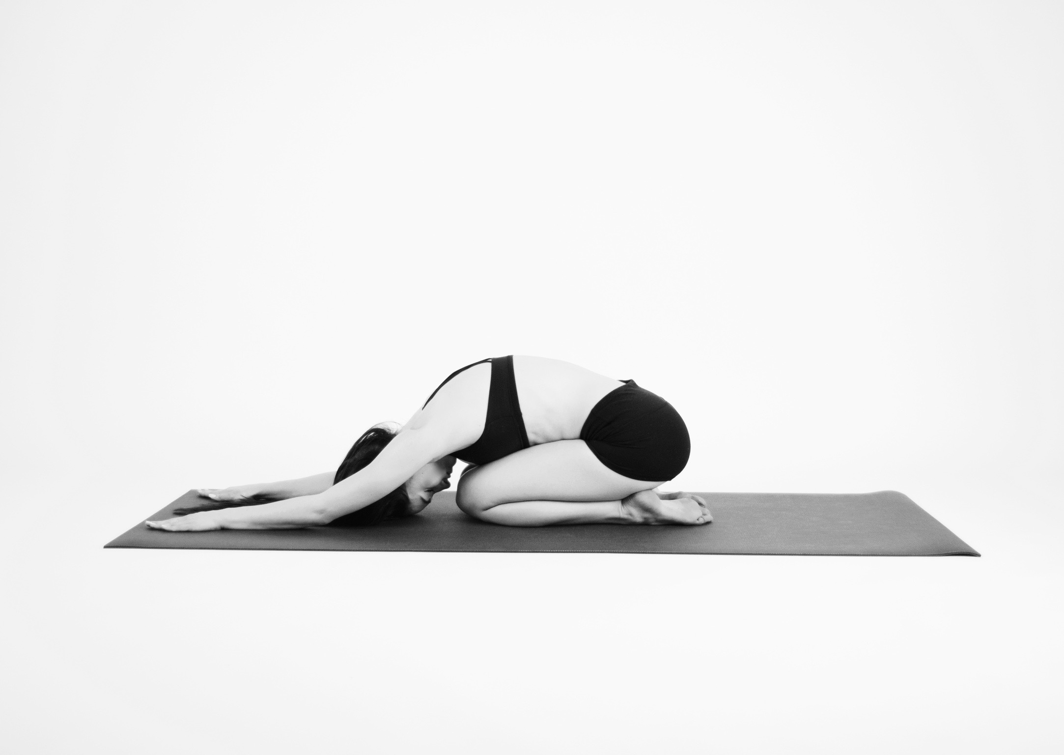 CHILD'S POSE  Start out in Child's Pose. From your hands and knees, sit your hips back onto your heels and rest your head down on your palms or the floor. Take 10 - 15 deep rounds of breath here.
