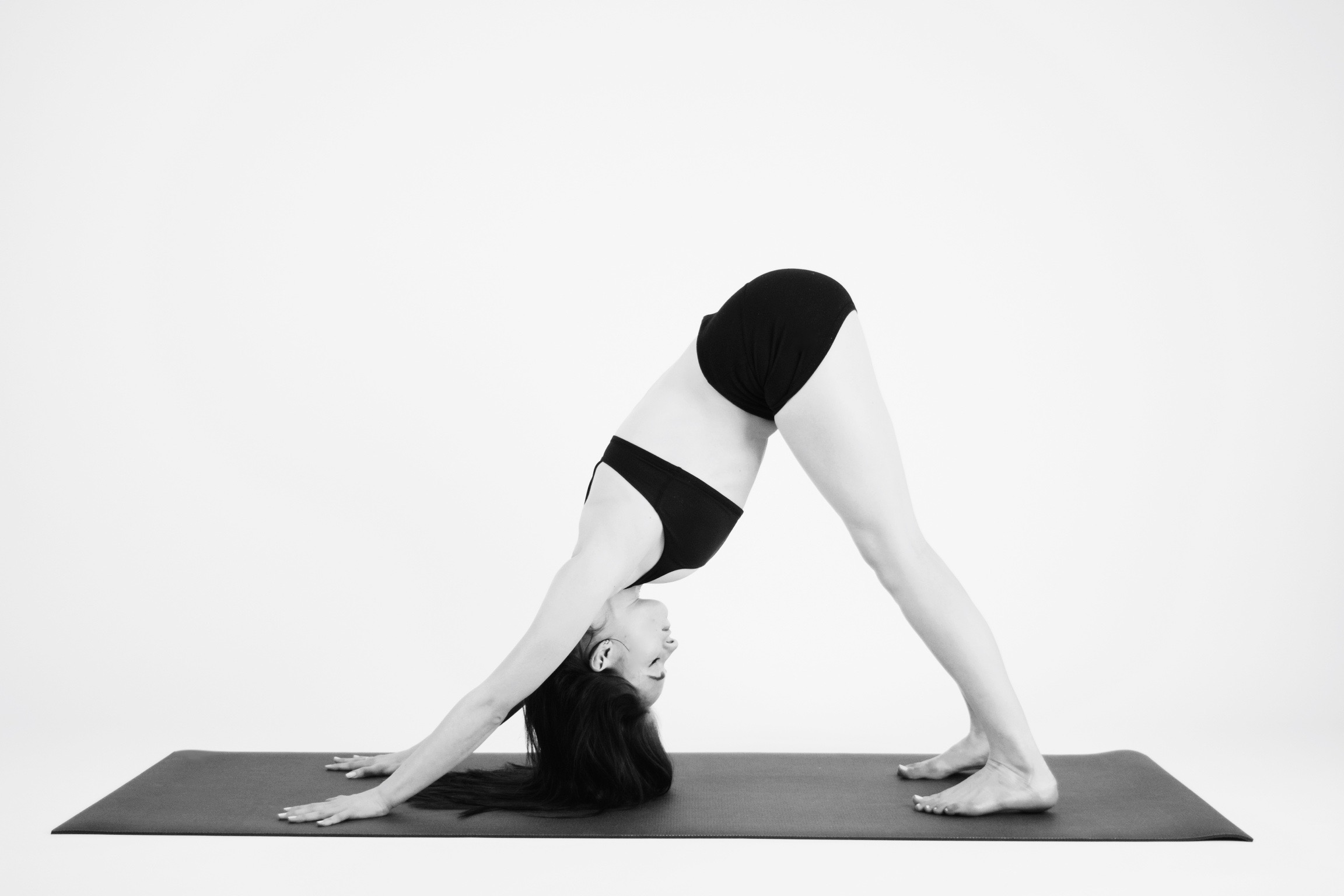 DOWNWARD FACING DOG  Tuck your toes under and lift your hips and your knees up and back to an upside down V shape. Spread your fingers wide and press your chest down towards your thighs. Try bending your knees, or maybe pedaling out from side to side.