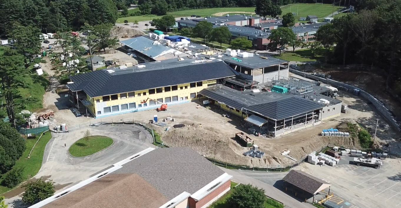 CONSTRUCTION, AS OF MID-AUGUST, UNDERWAY AT MILLIS' NEW ELEMENTARY SCHOOL.  THE OLD SCHOOL, WHERE STUDENTS ARE ATTENDING THIS YEAR, IS IN THE BACKGROUND. [CONTRIBUTED PHOTO/ELEMENTARY SCHOOL BUILDING COMMITTEE]