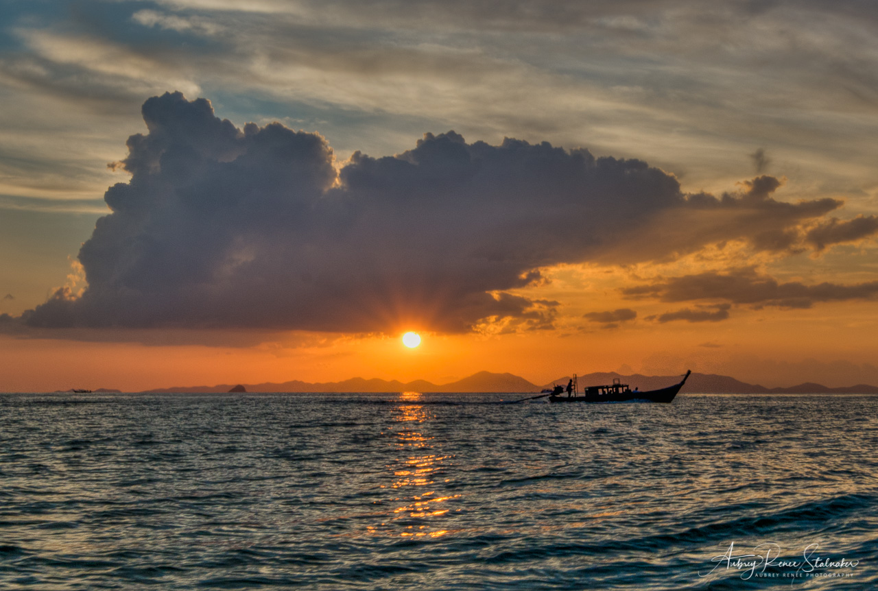 Longtail Boat Silhouette at Sunset in Krabi, Thailand