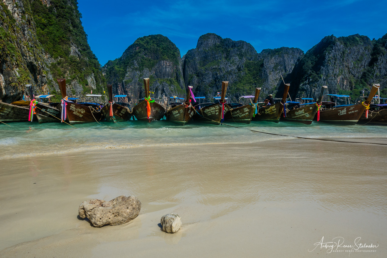 Line of Longtail Boats Moored at Railay Beach near Krabi, Thailand