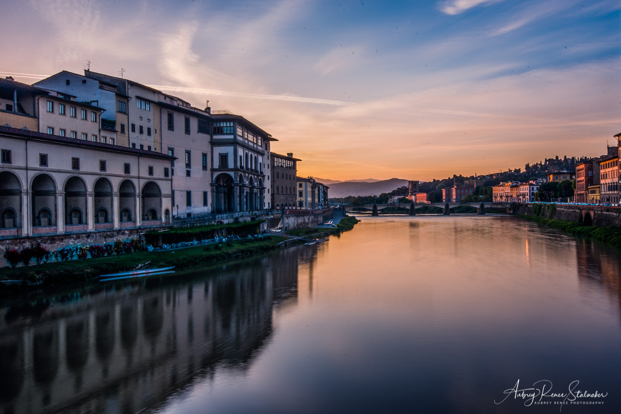 Dawn over the Arno River as seen from the Ponte Vecchio in Florence, Italy