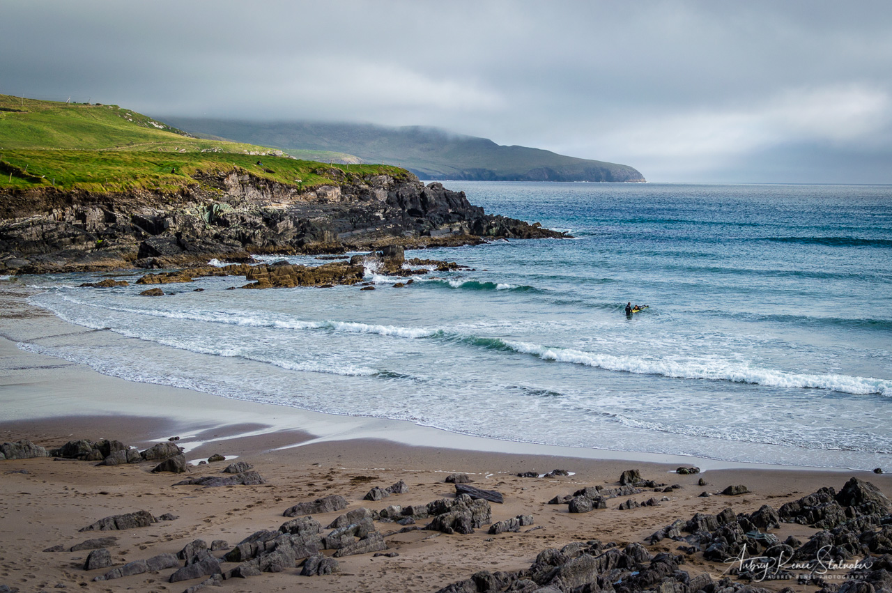 Surfers along the Skelling Ring in Ireland
