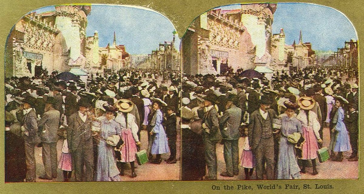 "Stereocard view of ""The Pike"" (the main boulevard of the fairground). Public Domain 