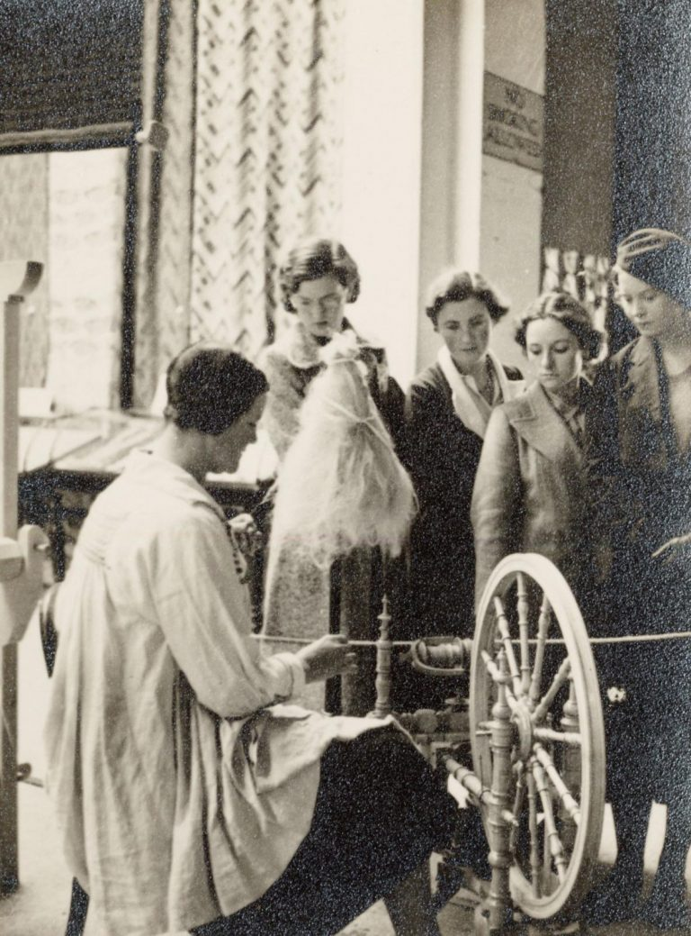 Black-and-white photograph of a spinning demonstration at the Whitechapel exhibition, Accession ID: 2002.21.54, Managed by the Crafts Study Centre