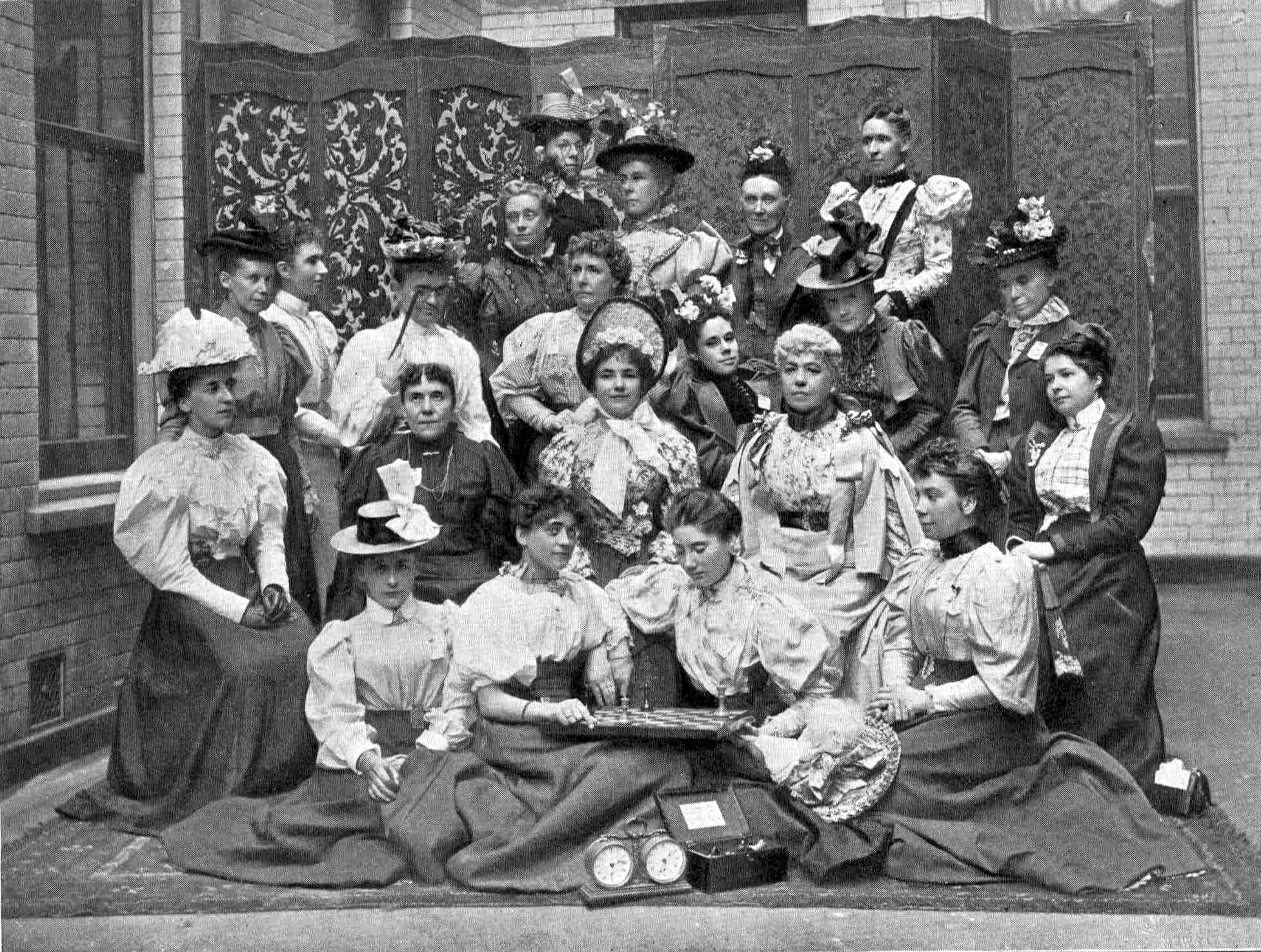 The first Ladies' International Chess Congress (1897) ( Wikipedia  | Public Domain)  Mary Rudge is seated on the far left of the second row. Lady Thomas and Louisa Fagan are the last two on the right of the third row.