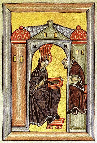 Hildegard von Bingen Received a divine inspiration and passes it on to her scribe ( Wikimedia Commons  | Public Domain)