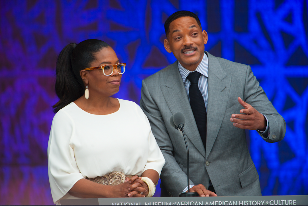 Figure 1.1 Oprah Winfrey (left), who donated over $20 million to the National Museum of African American History and Culture, at the museum's opening ceremony, with the actor Will Smith (right). Leah L. Jones for the NMAAAHC.