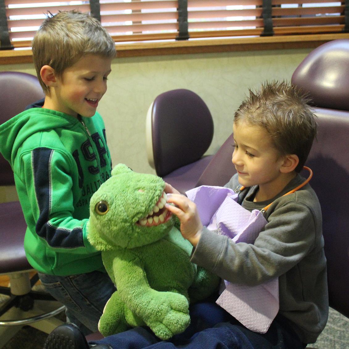 kids playing at dentist