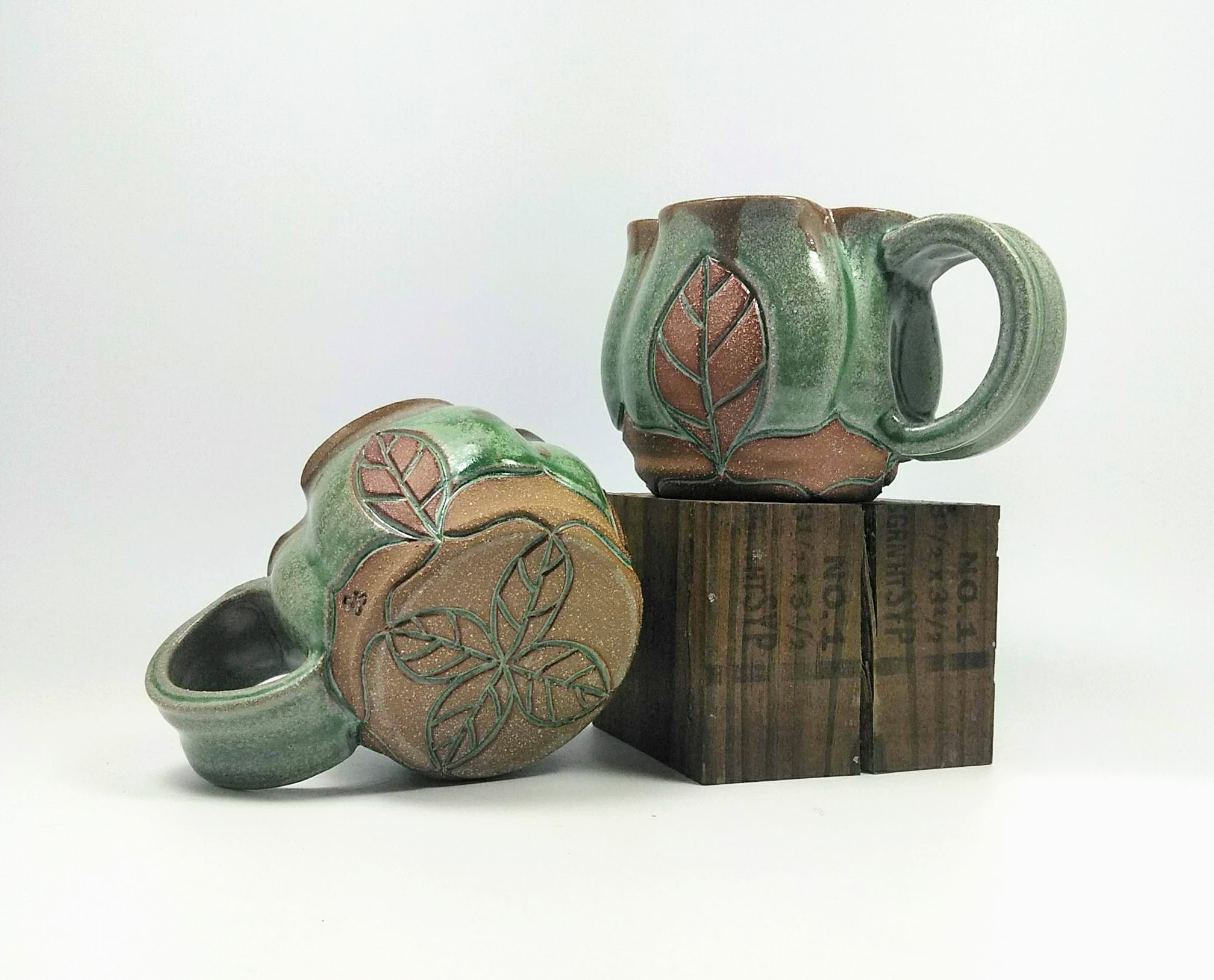 Carved Leaf Mug In Meadow Wheel Thrown Brown Stoneware Pottery Sara Bowen Pottery