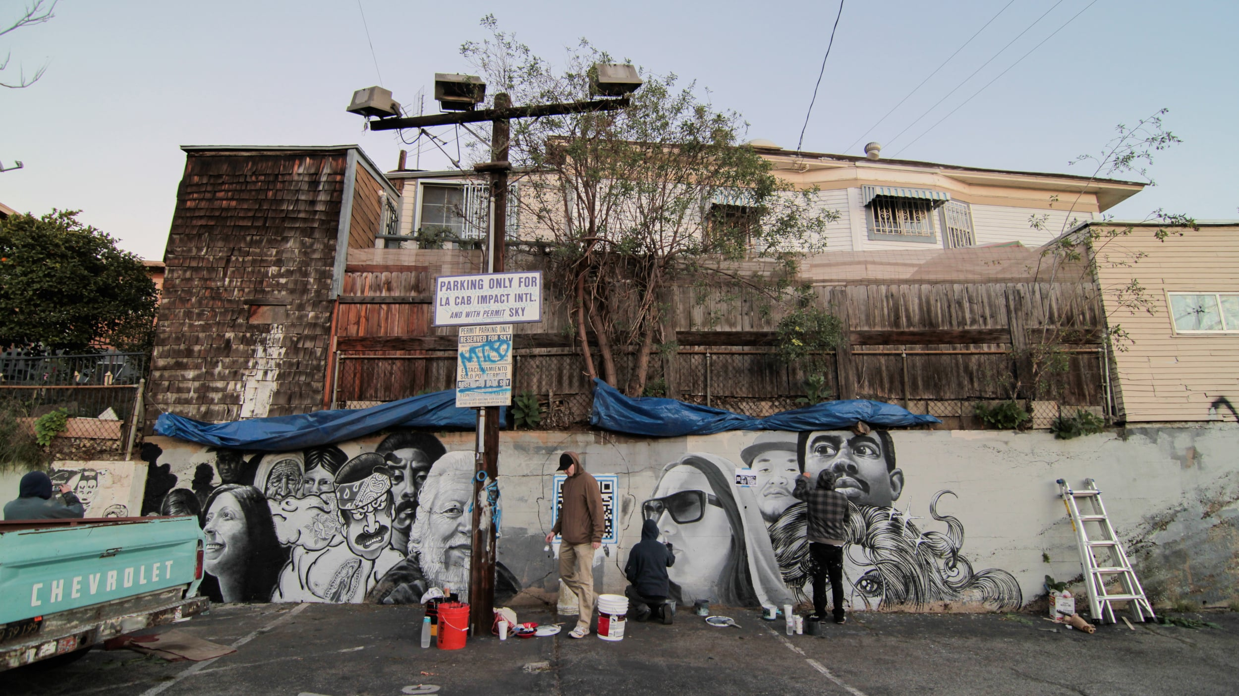 "QR Code process for ""L.A. Stories"" mural by Brand, Gattis, Martinez, & Skrederstu. Photograph courtesy of Sam Price-Waldman, 2013."