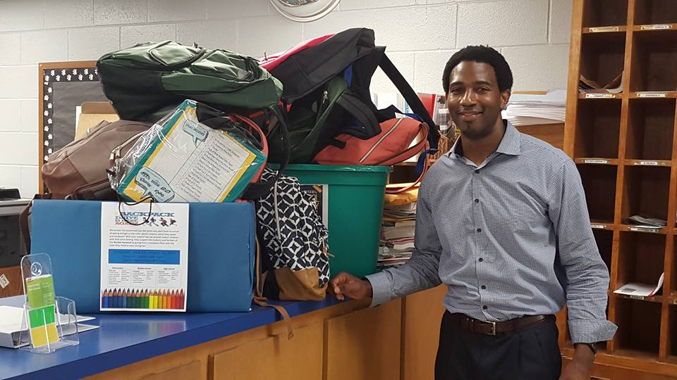 Supply Drive Aaron with Supplies_Aug2015.jpg