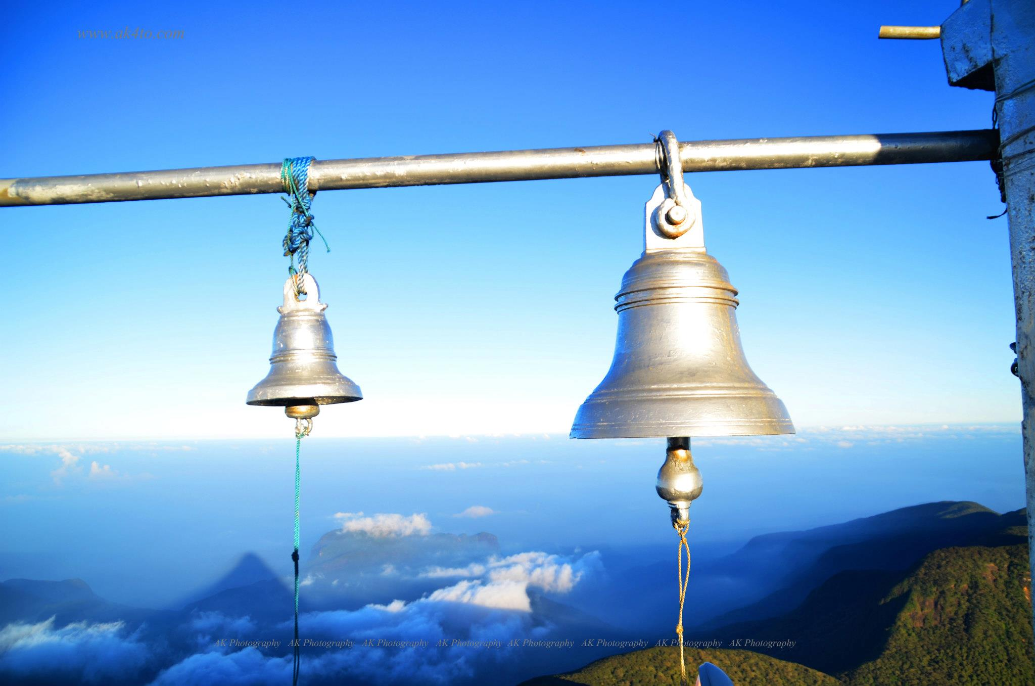 The bells at the Adams peak temple with the shadow of the mountain in the background