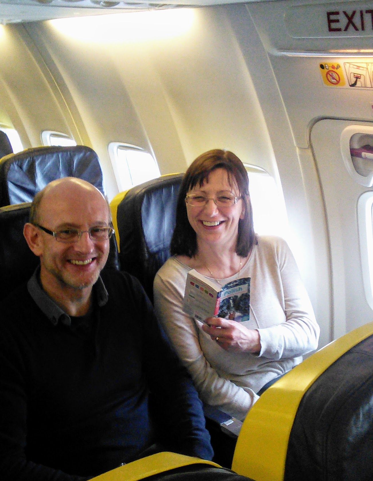 Sitting comfortably on our Ryanair flight! Anna is polishing up on her Polish!