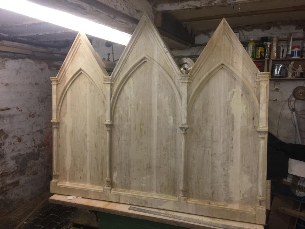 Carving out the mouldings and changing the depth of some of the areas by carving the columns and capitals.