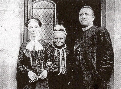 Miss Coulston (centre), flanked by Miss Smith and Fr Thomas Murphy