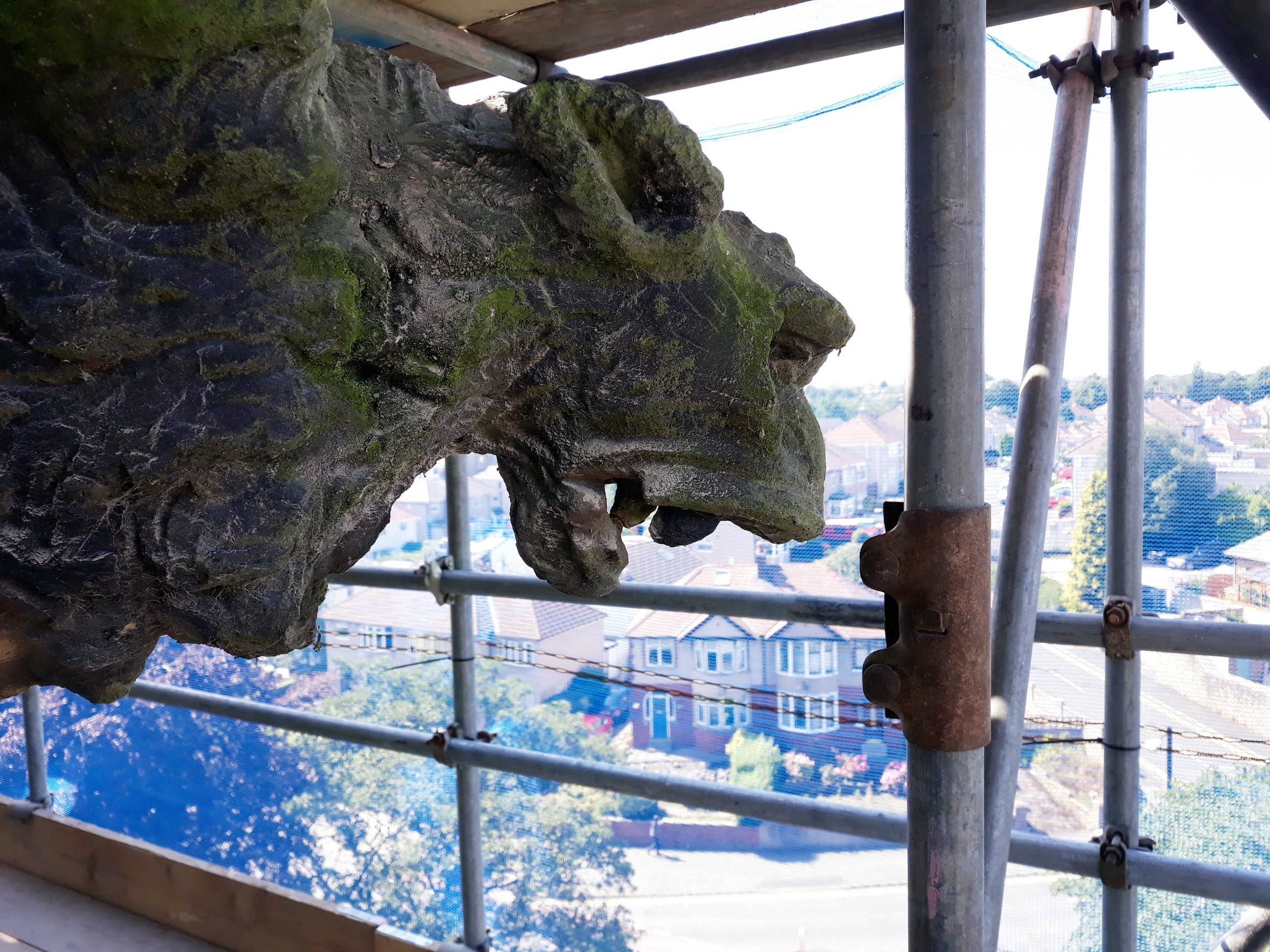 One of the grotesques, looking out from the tower