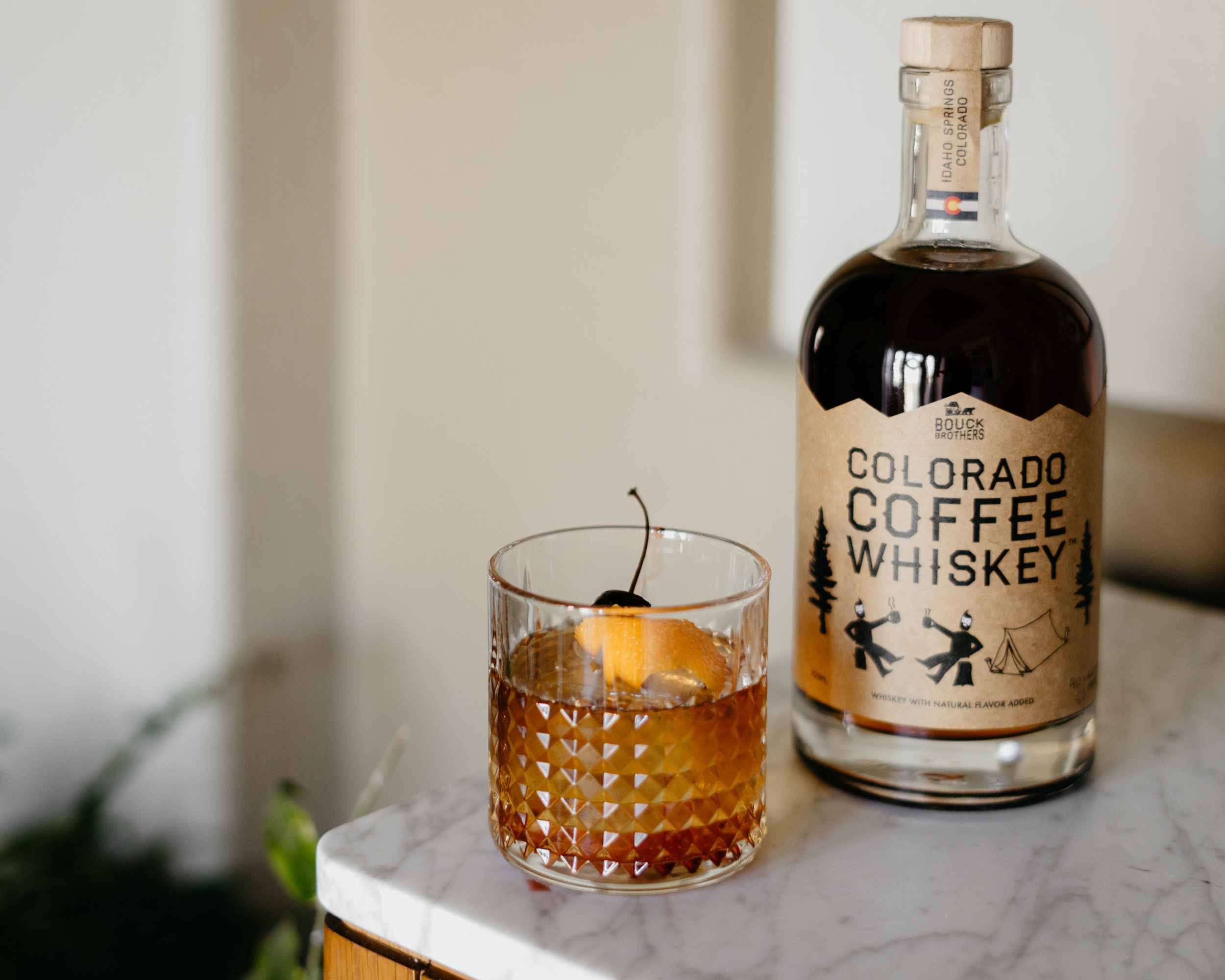 Coffee Walnut Old Fashioned - 2 oz Colorado Coffee Whiskey1/4oz real maple syrup2 dashes Fee Brothers Black Walnut Bitters.Stir ingredients together in a lowball glass, add a few ice cubes and enjoy! Garnish with a strip of orange zest and a cherry, if you're feeling fancy.