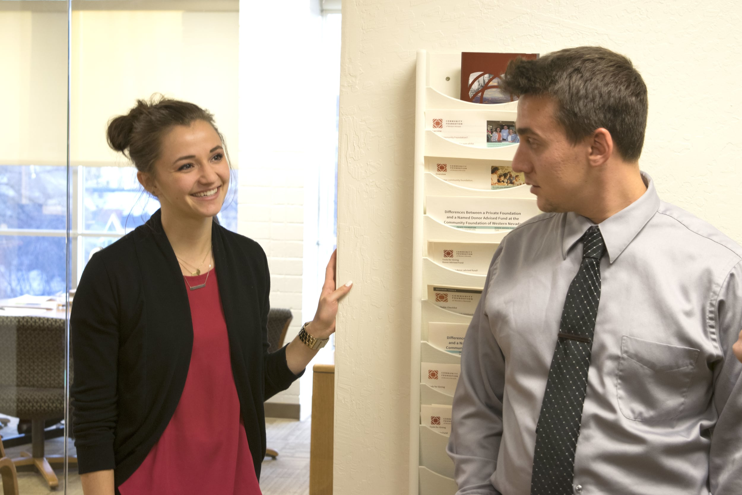 Nick works with colleague Camille Glanzmann at the Foundation on homeless youth issues. Photo by Jose Olivares.
