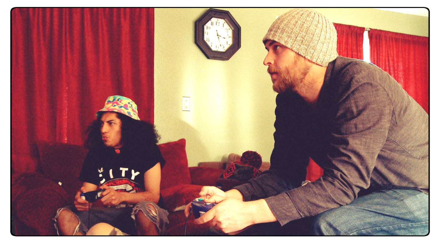 Daniel plays video games with Brian Eddy at the Eddy House's Yosemite Place.