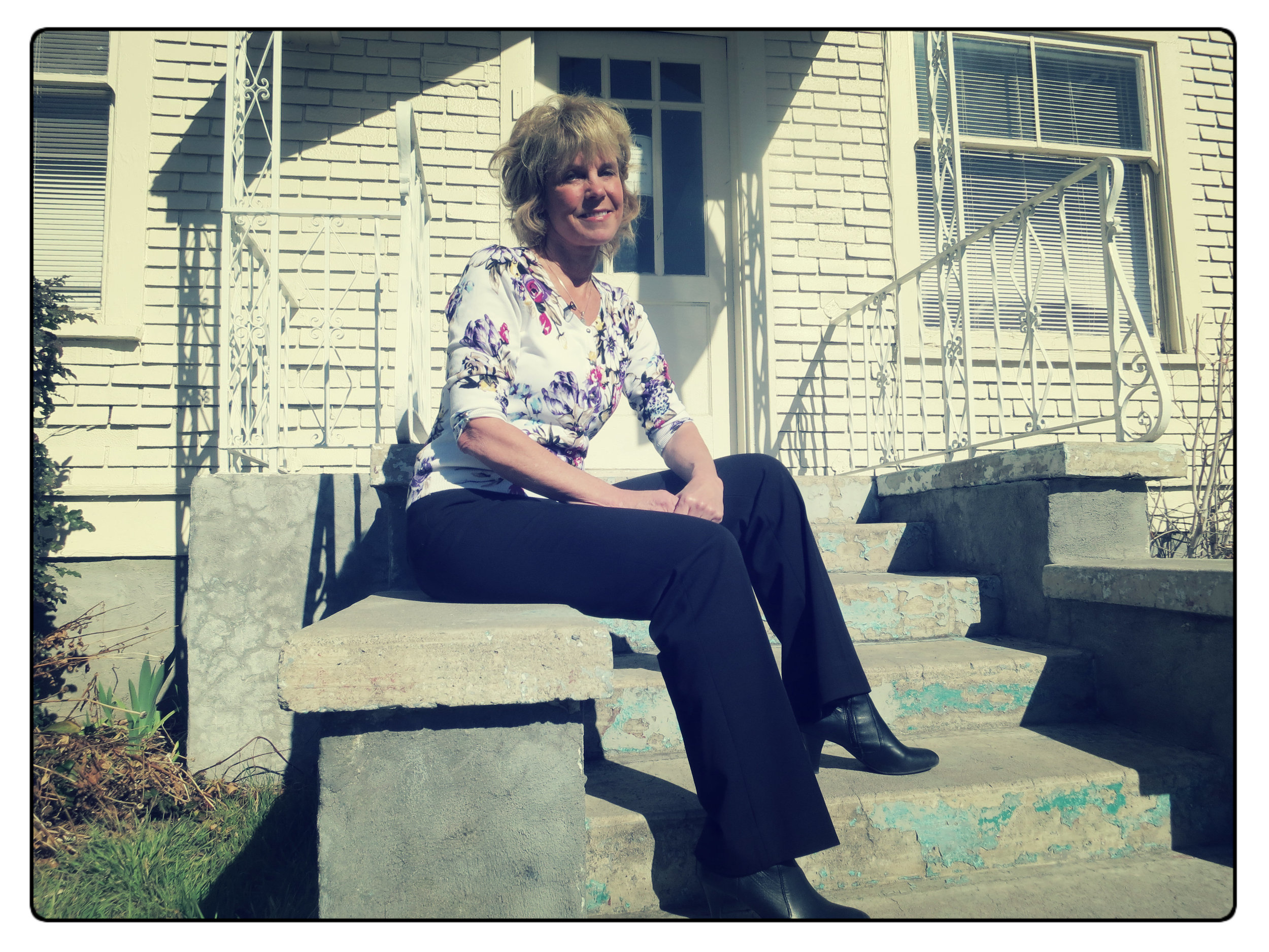 Lynette Eddy sits in front of the You, a resource center for at-risk, runaway and homeless kids which opened last year.