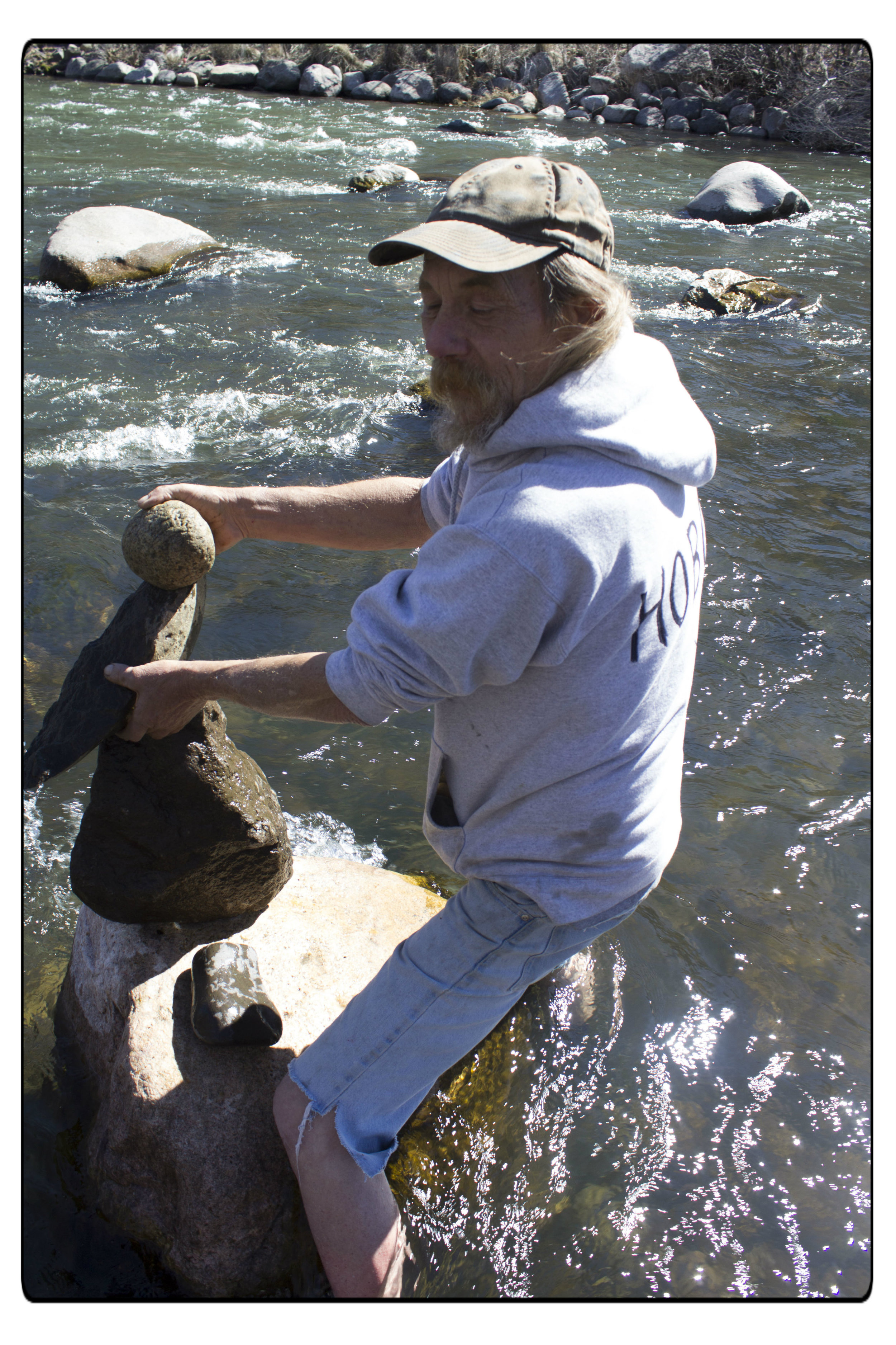 Hobo was making a rock sculpture on a big rock in the Truckee river in February 2016. Photo by Camille Loustalet
