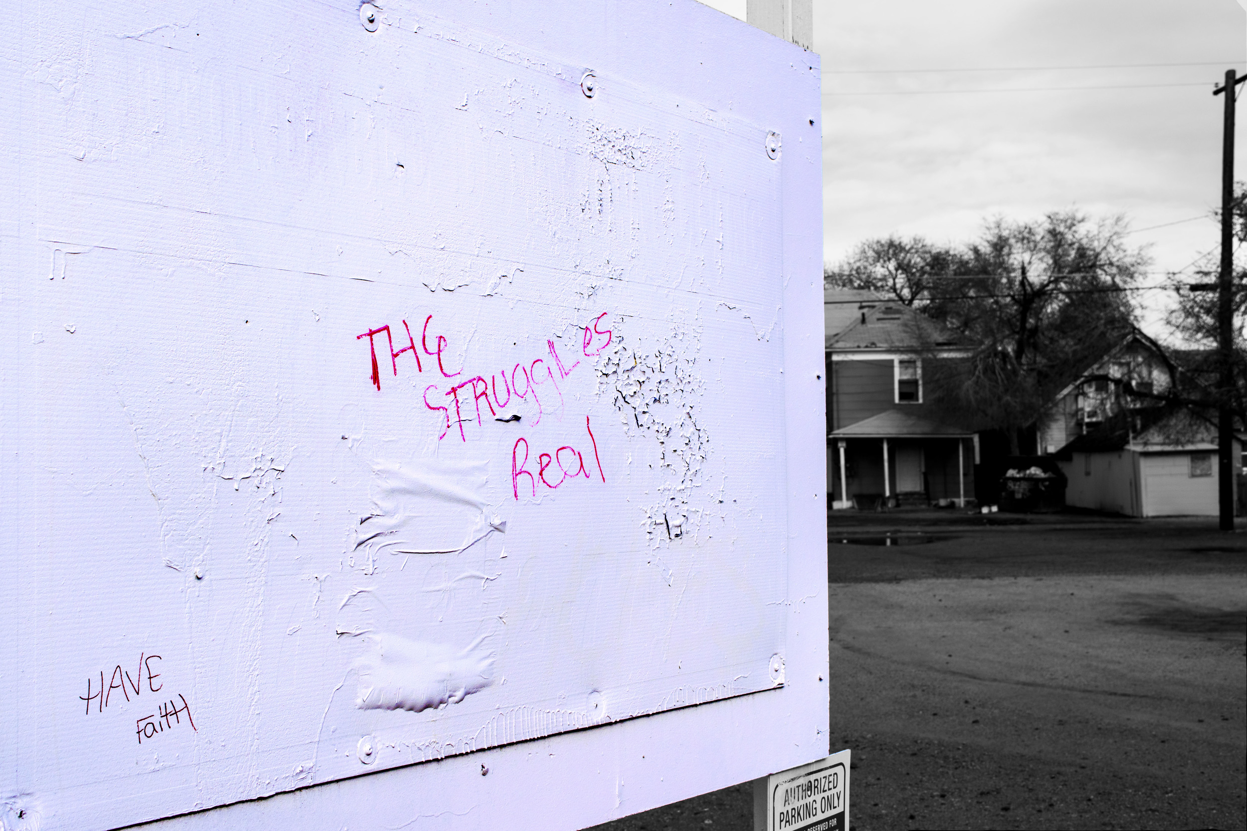 "A graffiti on the block set for demolition reads ""The Struggle's Real"". Many current residents said they heard about the plan for student housing in the newspaper.  Photo by Jose Olivares."