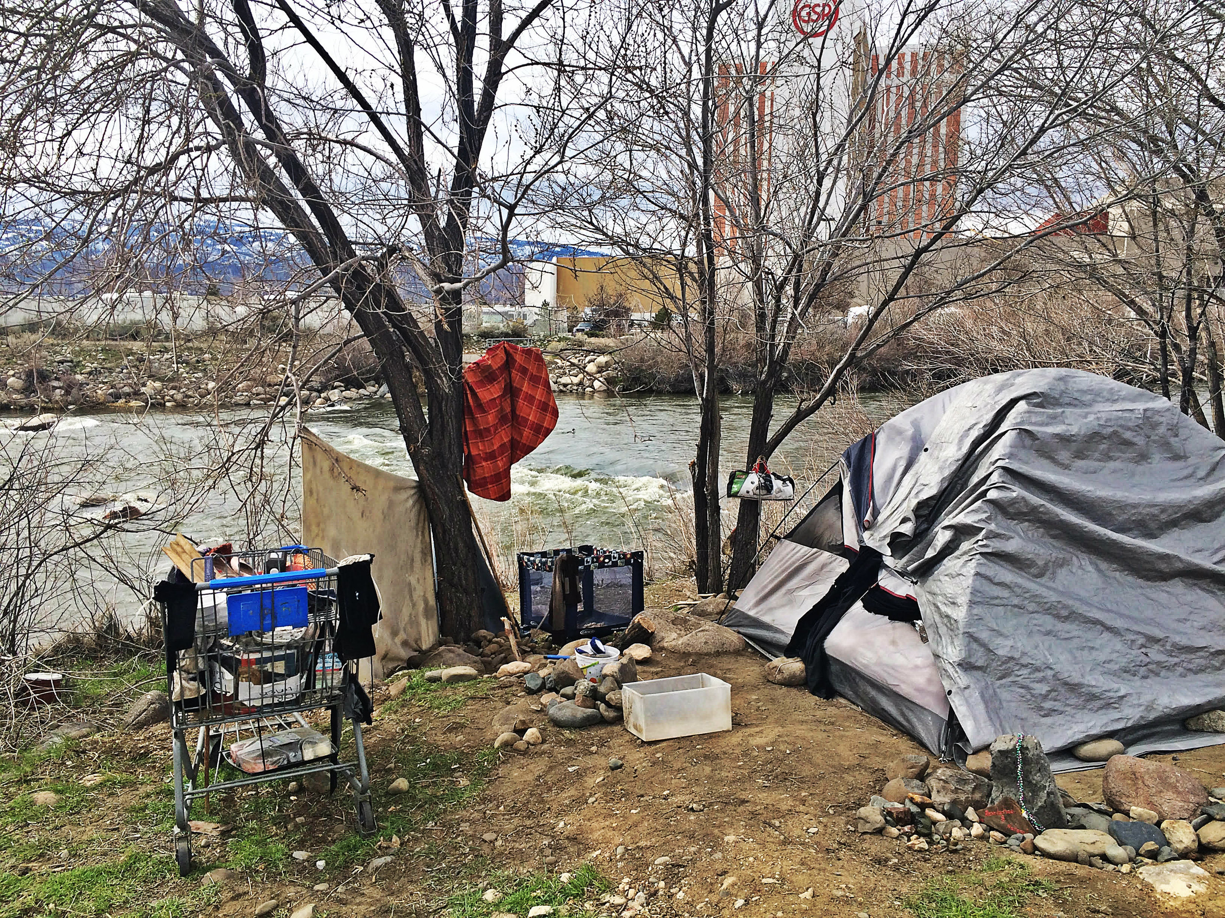 Authorities in Sparks are considering shutting down this encampment site, which keeps reappearing, along the Truckee River. Photo by Monica Gomez