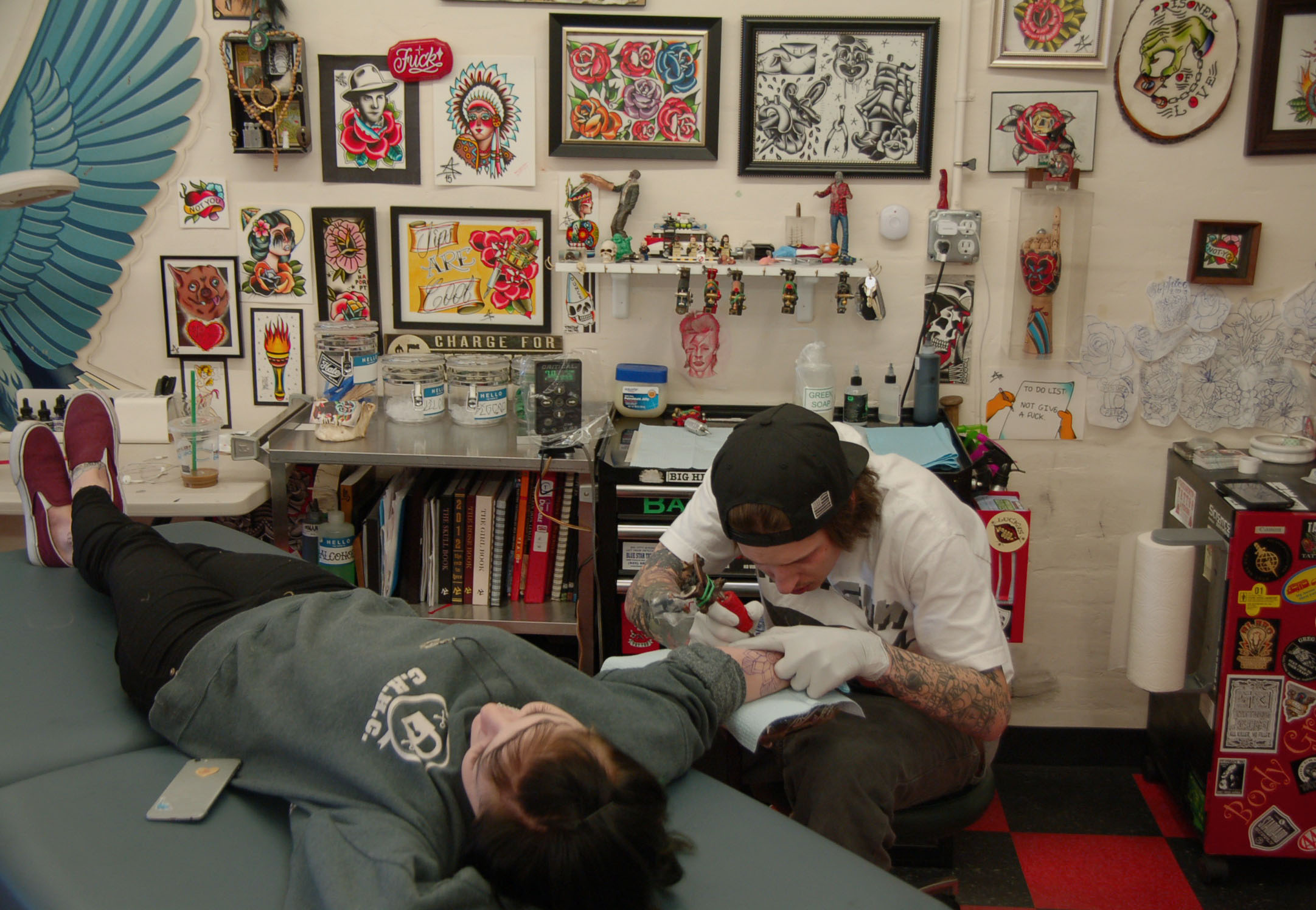 """Destany Swan was having Stewart tattoo a flower on her right arm on March 13, 2016. """"Anthony is super talented,"""" Swan said. """"I like his line work, we have a lot of similar interests in tattoos. So many of my friends' dads have been tattooed here. It's just an amazing place."""""""